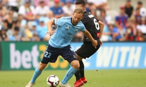 Siam de Jong of Sydney FC and Steven Ugarkovic of Newcastle Jets contest possession at Jubilee Stadium.