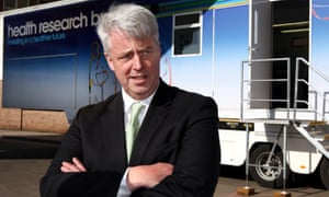 Former Health Secretary Andrew Lansley, during a 2012 visit to Birmingham Queen Elizabeth Hospital where he was given a tour of an NHS research facility