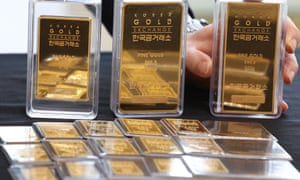 A clerk shows gold bars at the Korea Gold Exchange in Seoul, South Korea, 24 May 2021.