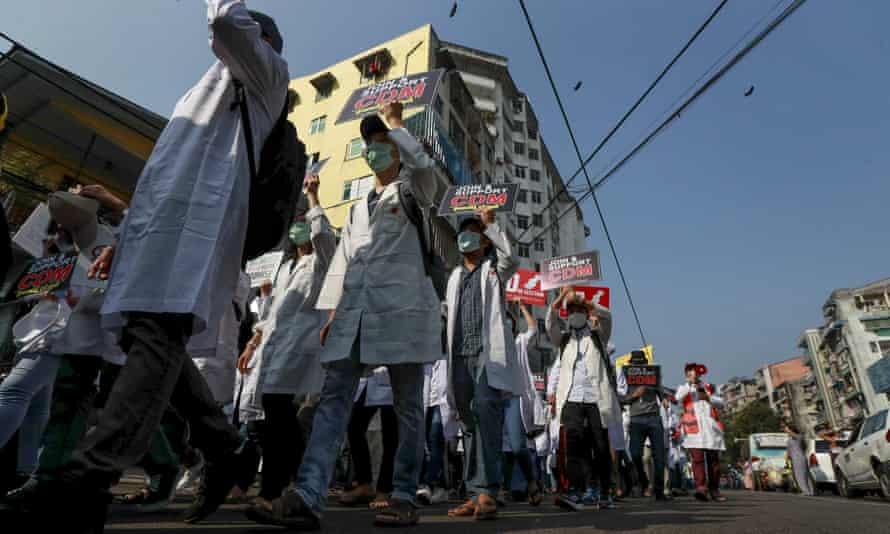 Doctors take part in an anti-coup march in Yangon in February