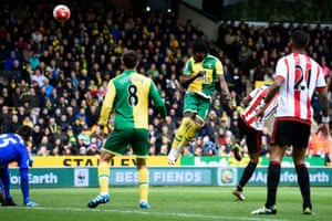 Dieumerci Mbokani heads at goal with Mannone on the floor.