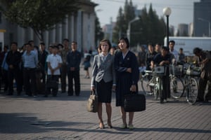 North Koreans gather in Pyongyang to watch a news broadcast of a statement by Kim Jong-un