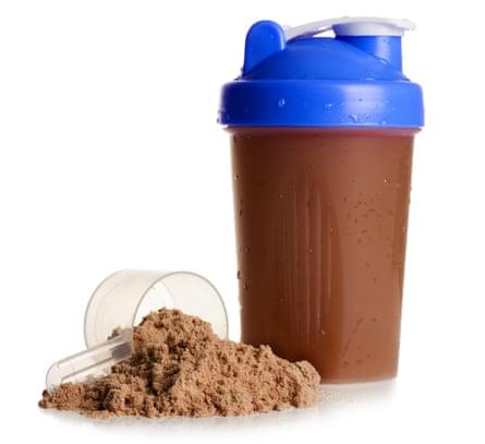 Protein shake with protein powder on a white background