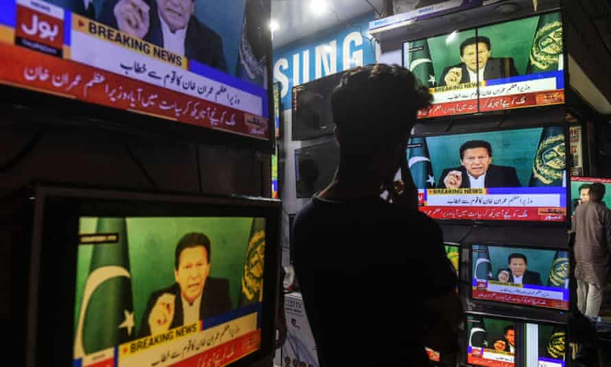 A shopkeeper watches Pakistan's prime minister Imran Khan on television, Karachi, March 2021