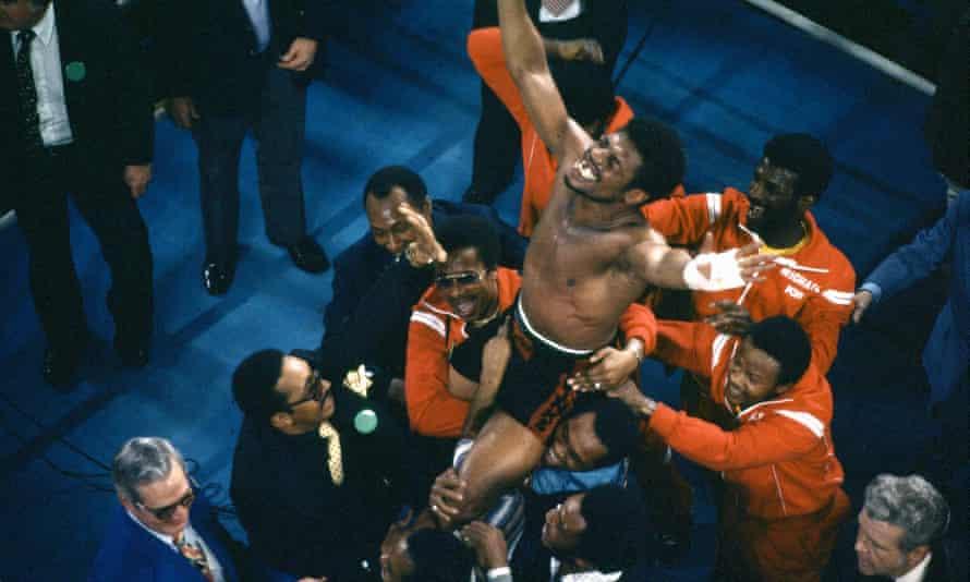 Leon Spinks celebrating his 15-round split decision victory over Muhammad Ali in Las Vegas.