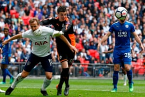Keeper Eldin Jakupovic gets to grips with Harry Kane.