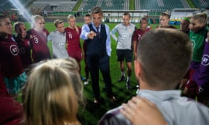 England manager Phil Neville talks to his players after the 1-0 win over Portugal