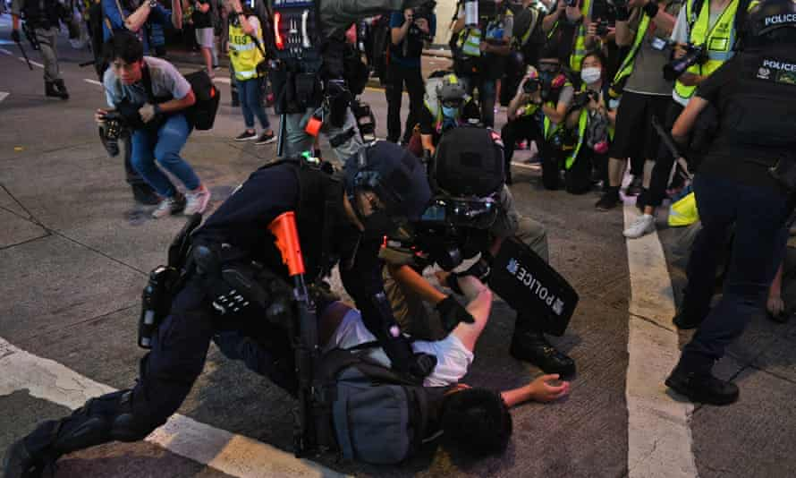 Riot police detain protesters during a rally against the new national security law in July.