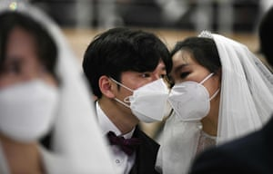 Couple wearing masks, talking to each other