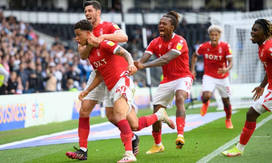 Brennan Johnson celebrates Nottingham Forest's late equaliser with teammates