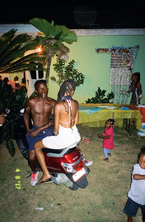 """Paul and Shanae, 2017 … Paul, one of Wigan's closest friends, and his girlfriend Shanae live in a small community called Whitehall in western Jamaica. They invited him to this children's party. Just as it is ending, Paul is """"lighting up a spliff to put the day to rest""""."""