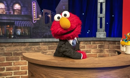 Elmo, whose father Louie said in the CNN town hall that 'Racism is when people treat other people unfairly because of the way they look or the color of their skin.'