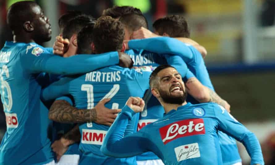Napoli players celebrate after Marek Hamsik's winner at Crotone.