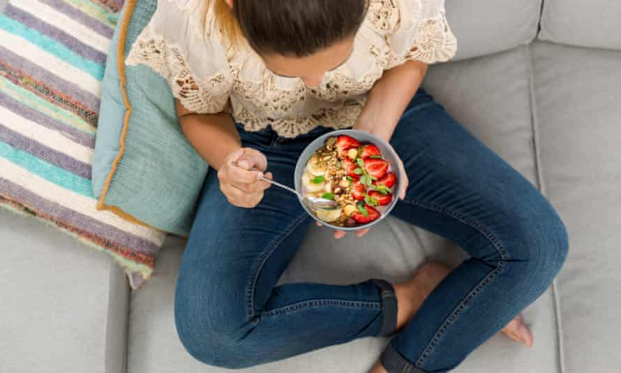 Woman eating a healthy bowl