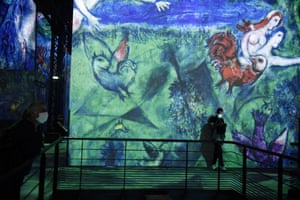 Visitors attend the exhibition Monet, Renoir, Chagall: Journeys around the Mediterranean at the Atelier des Lumières Museum in Paris, France