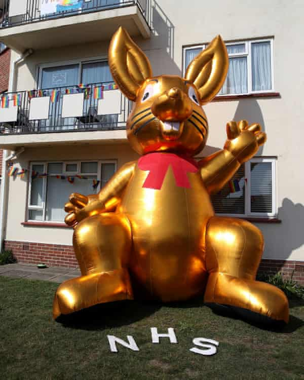 A giant inflatable Easter bunny and messages of support for the NHS are seen at Belle Vue Mansions in Southbourne, Dorset.