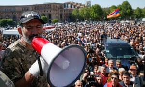 Nikol Pashinyan speaks through a megaphone to a crowd of protesters in Yerevan