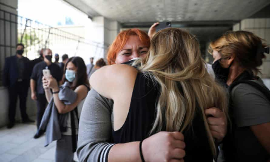 Irini Fyssa, the sister of the Greek rapper Pavlos Fyssas, who was killed in 2013 by a Golden Dawn supporter, reacts after the verdict