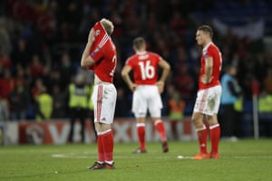 Wales' players react at full-time.
