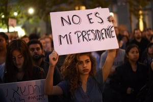 Protesters in Oakland, California. The sign reads: 'He is not my president.'