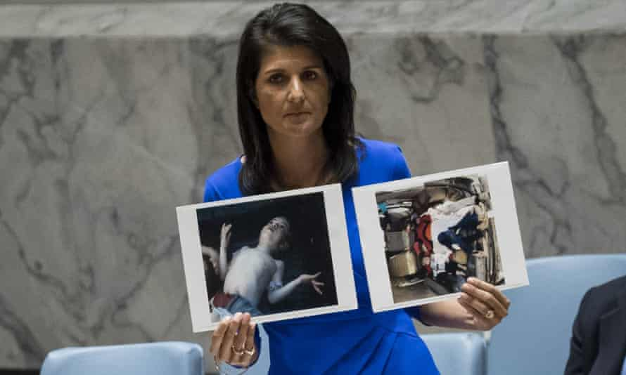 Nikki Haley, US ambassador to the UN, holds up photos of victims of the Syrian chemical attack during a meeting of the UN security council.