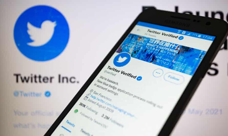 A Twitter verified account displayed on a smartphone