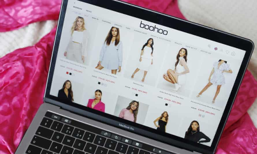 Boohoo's website is displayed on an Apple laptop
