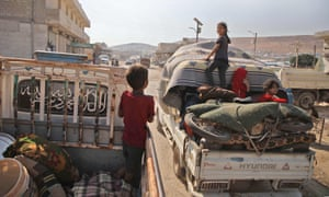 Displaced Syrians who fled from their villages near Jibala to escape bombing by Syrian government forces, return home
