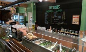 Interior shot of the counter, with its salad bar, at Earth Cafe, Manchester