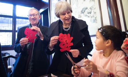 Theresa May and her husband, Philip, meet schoolchildren in Shanghai.