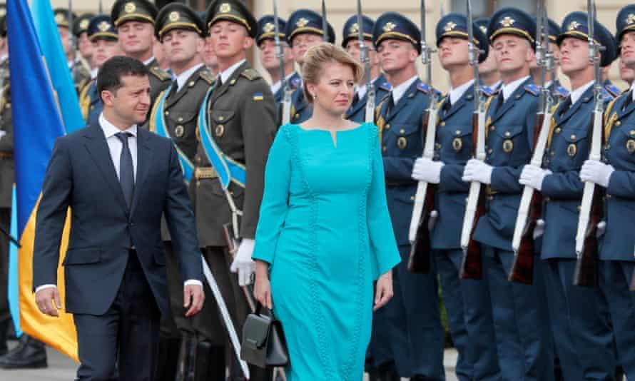 The Ukrainian president, Volodymyr Zelenskiy, reviews the guard of honour with his Slovak counterpart Zuzana Caputova at the Mariinskiy Palace in Kiev, Ukraine.