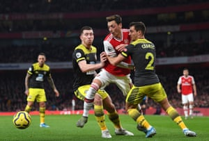 Arsenal's Mesut Ozil, held back by Southampton's Pierre-Emile Hojbjerg and Cedric during the 2-2 draw at the Emirates Stadium.