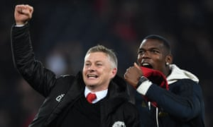Ole Gunnar Solskjær and Paul Pogba celebrate Manchester United's dramatic win at PSG in March 2019