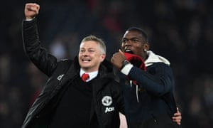 Ole Gunnar Solskjær celebrates Manchester United's remarkable comeback win against PSG with Paul Pogba, one of the players excelling under his management.