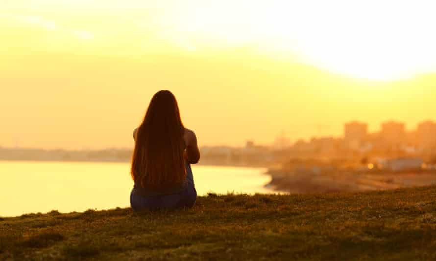 young person looking at sunrise