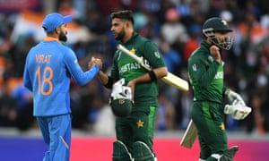 India captain Virat Kohli shakes hands with Pakistan batsman Imad Wasim.