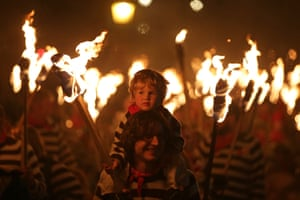 Boy surrounded by torches