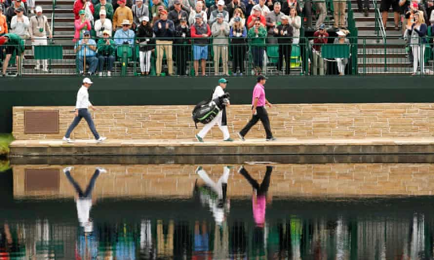 Patrick Reed leads Rory McIlroy towards the 15th green near the climax of the 2018 Masters. Who will broadcast the 2019 tournament in the UK is increasingly in question.