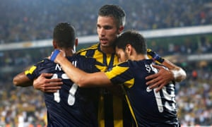Fenerbahce's former Manchester United striker Robin van Persie, centre, celebrates a goal with Nani and Sener Ozbayrakli.