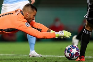 Lyon keeper Anthony Lopes pounces on the ball.