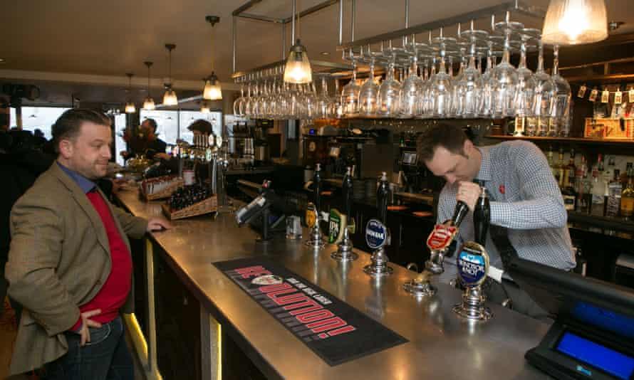 A barman pulls a pint in a JD Wetherspoon pub