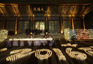 Buddhists light candles during New Year celebrations at Jogye Buddhist temple in Seoul, South Korea
