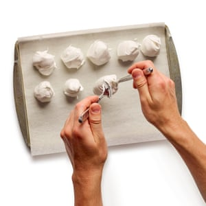 2 Spoon blobs of meringue on to a paper-lined baking tray.