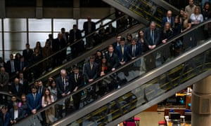 Employees line the balconies and escalators of the Lloyd's Building during a service of remembrance in London on 8 November 2019.