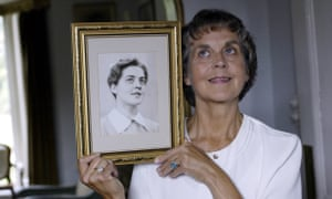 Jennifer Worth with a photograph of herself as a midwife in the 1950s.
