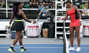 Serena Williams and Venus Williams touch rackets after Serena's 3-6, 6-3, 6-4 win in the Top Seed Open.