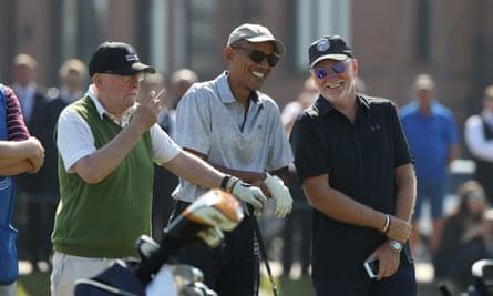 Barack Obama speaks to Sir Tom Hunter (right)