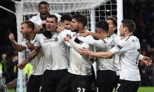 Ragnar Klavan leads the celebrations after scoring Liverpool's late winner against Burnley at Turf Moor