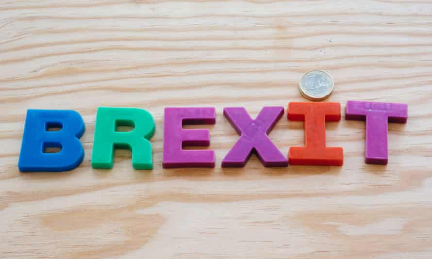 Colorful brexit text on wooden background with euro coin