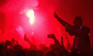 The use of flares by Liverpool supporters is also being investigated by police